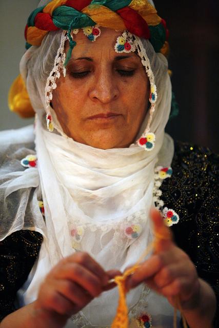 Woman in Headpiece Knitting
